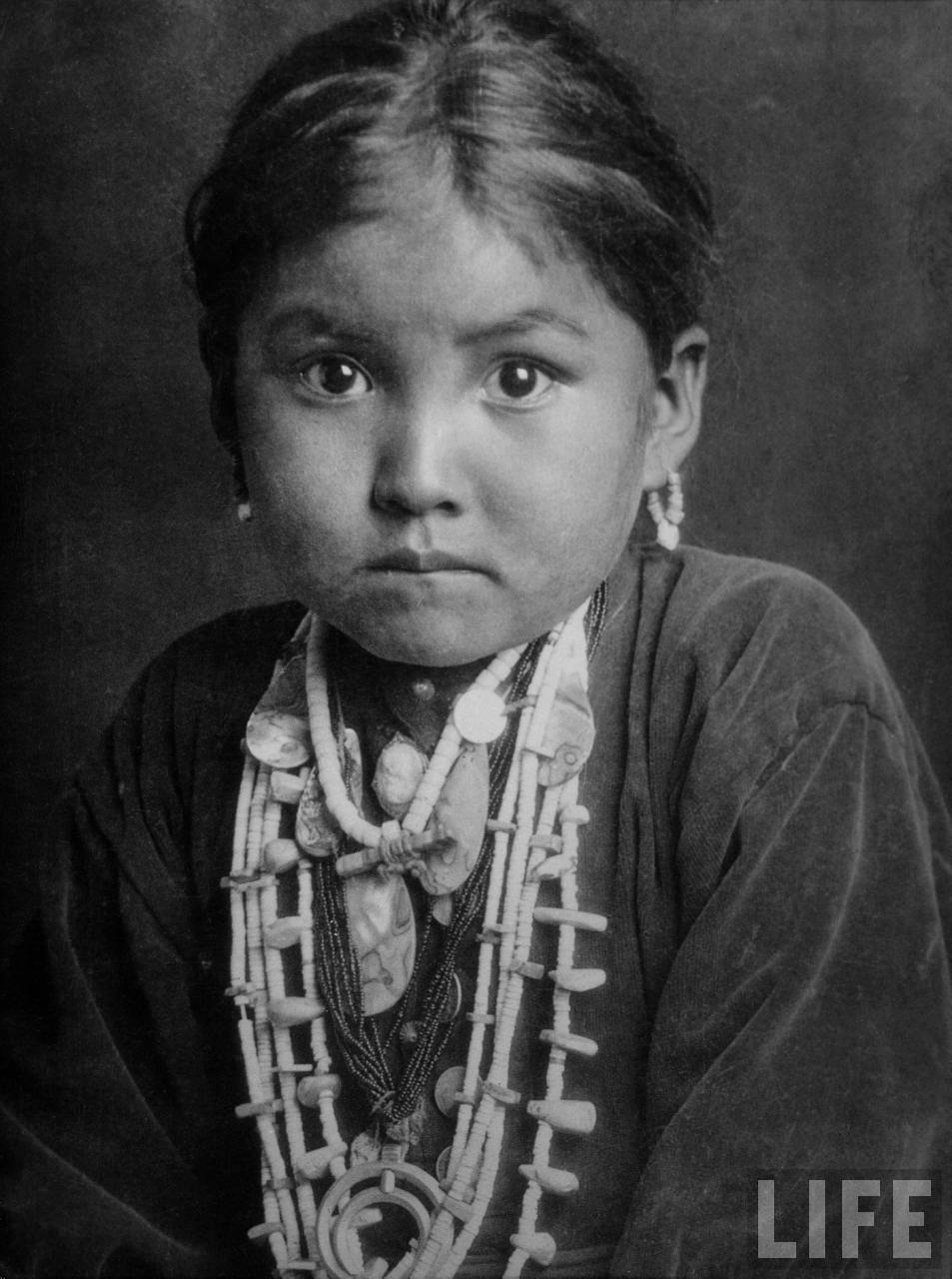 Portrait of small girl in costume, who is Native American Navajo princess.