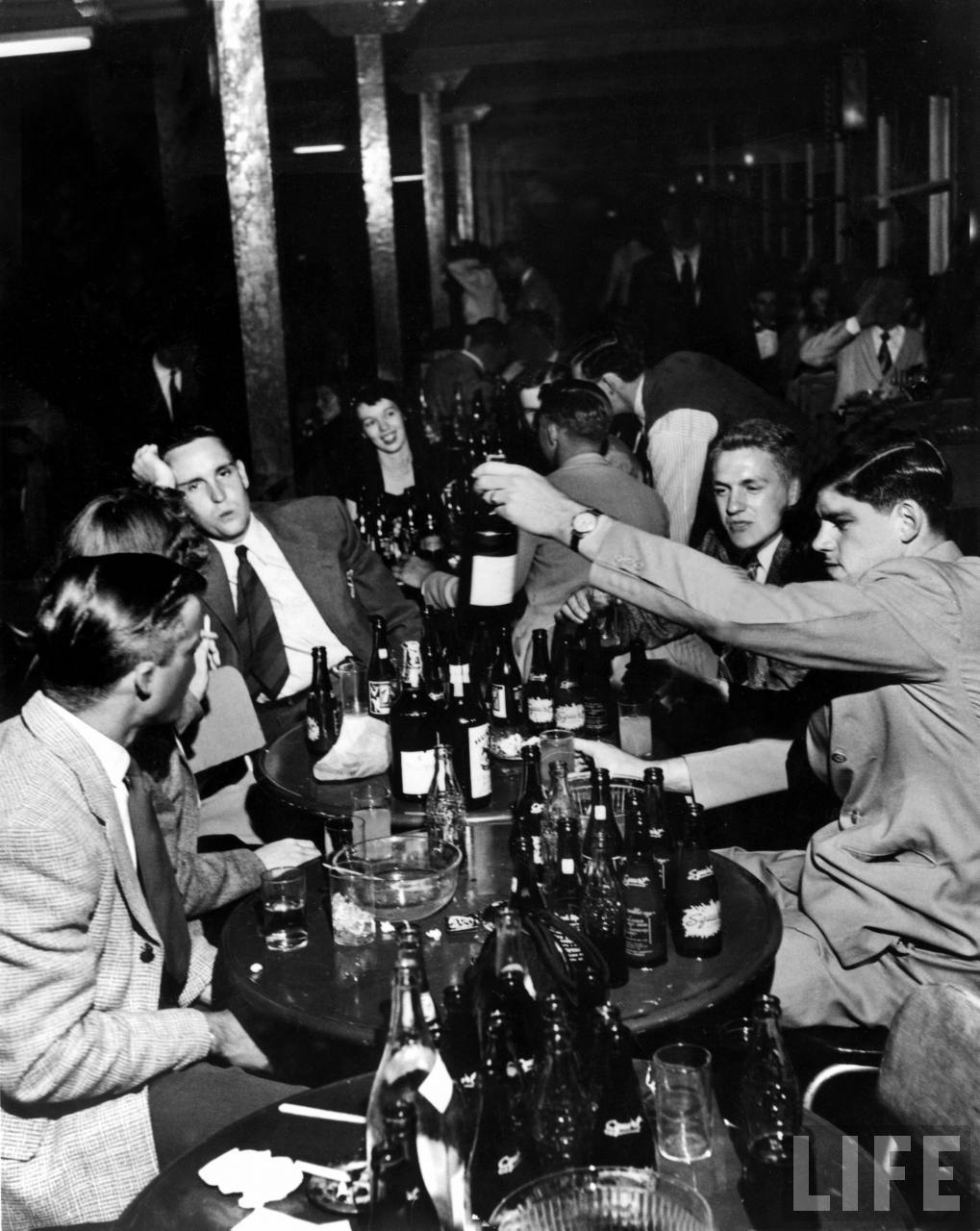 Men and women in Kansas roadhouse, during prohibition.