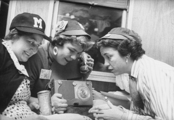 Baseball fans listening to a game on the radio in 1956