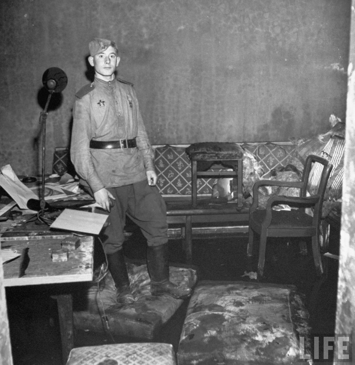 Russian soldier standing amid rubble in Adolf Hitlers command bunker where he and his mistress Eva Braun were alleged to have committed suicide, under the Reichschancellery bldg.Russian soldier standing amid rubble in Adolf Hitlers command bunker where he and his mistress Eva Braun were alleged to have committed suicide, under the Reichschancellery bldg.