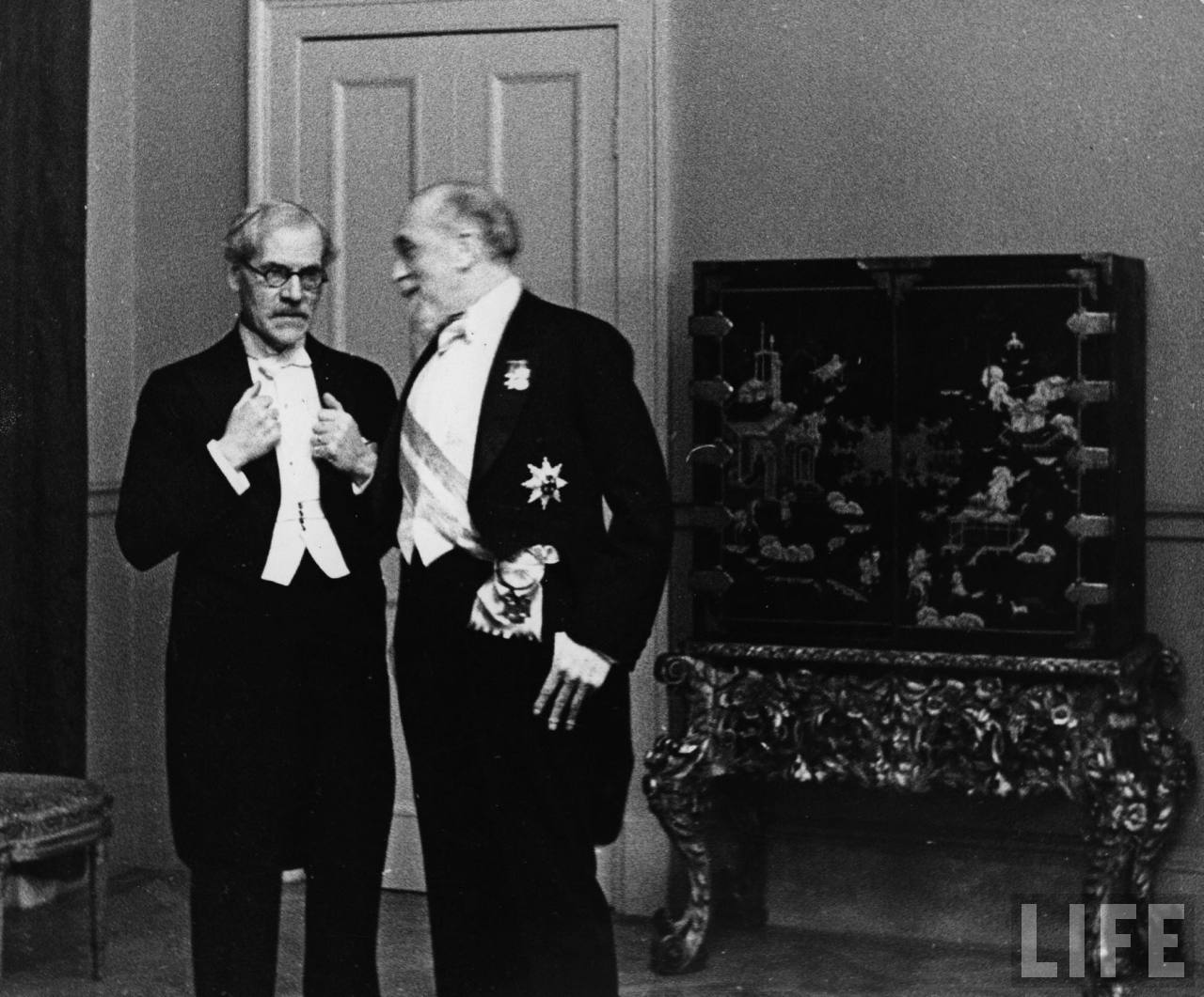 (L-R) Prime Minister Ramsay MacDonald of Great Britain and Governor of The Bank of England Montague Norman attending diplomatic reception at Austrian Legation. 1932, Photographer - Erich Salomon