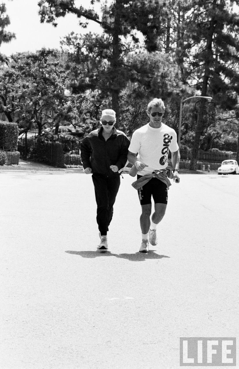 Madonna jogging with unidentified trainer