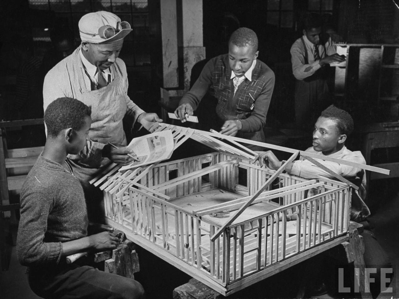 A view of a class doing an exercise in practical carpentry.