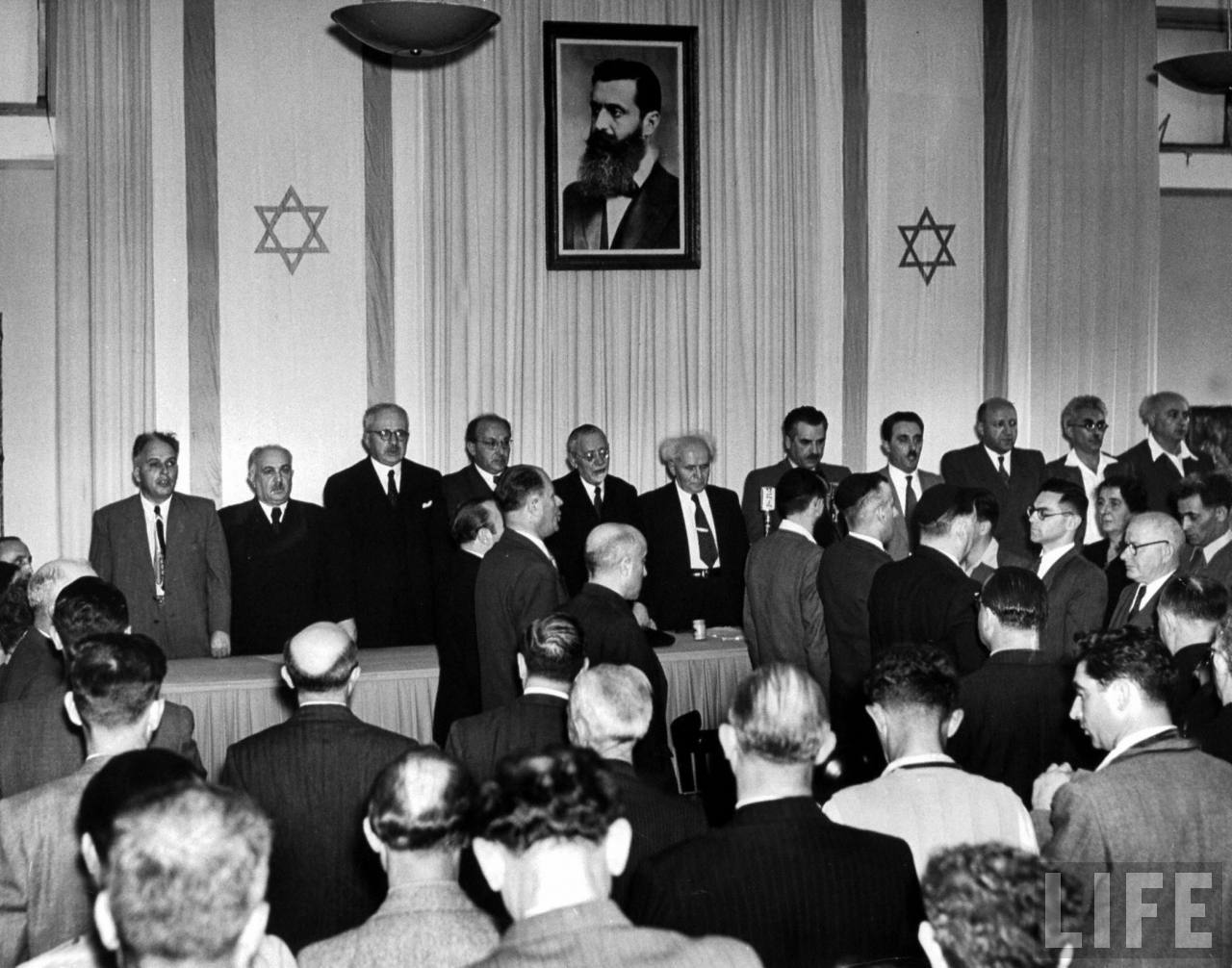 Prime Minister Dave Ben-Gurion (6L), Foreign Minister Moshe Sharett (4R) and Labor Minister Moshe Ben-Tov (2R) at Proclamation of nationhood of Israel.