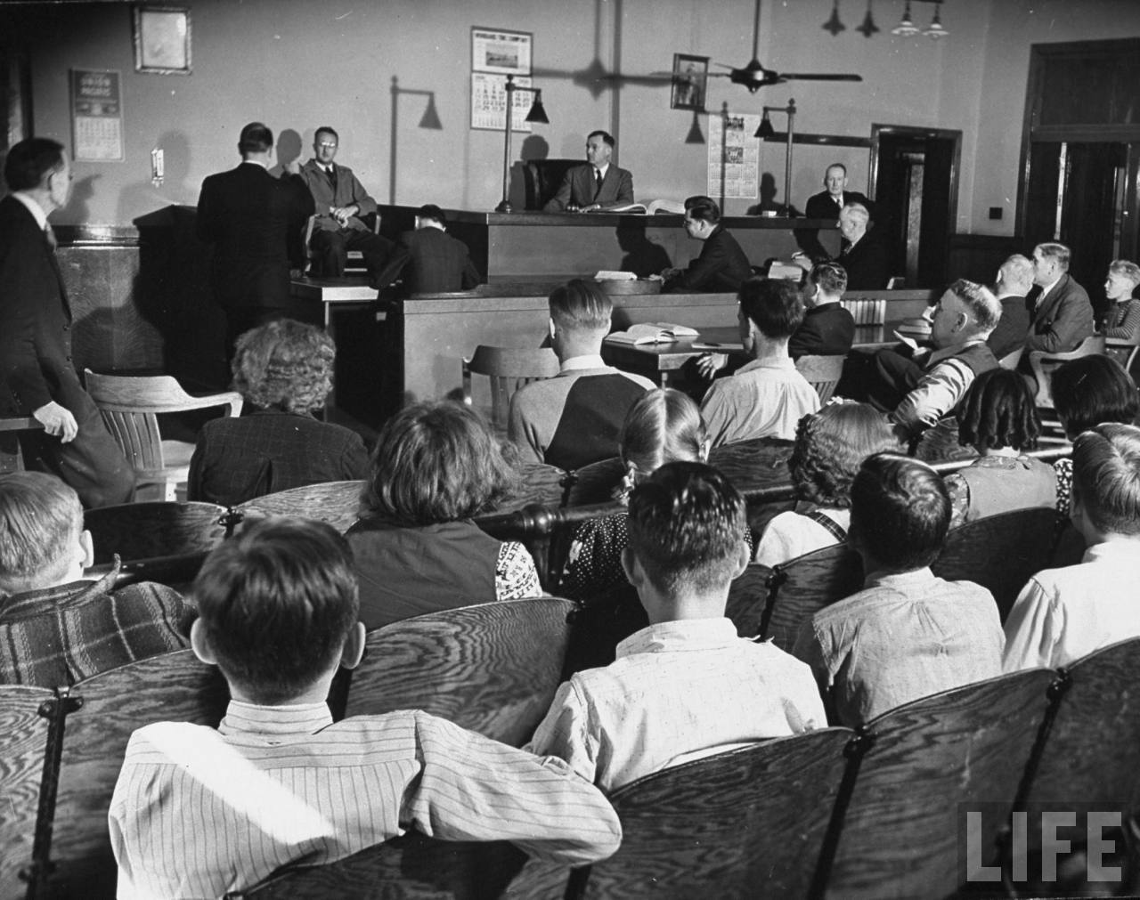 A view of a sixth grade class attending a town meeting during a lesson on government.