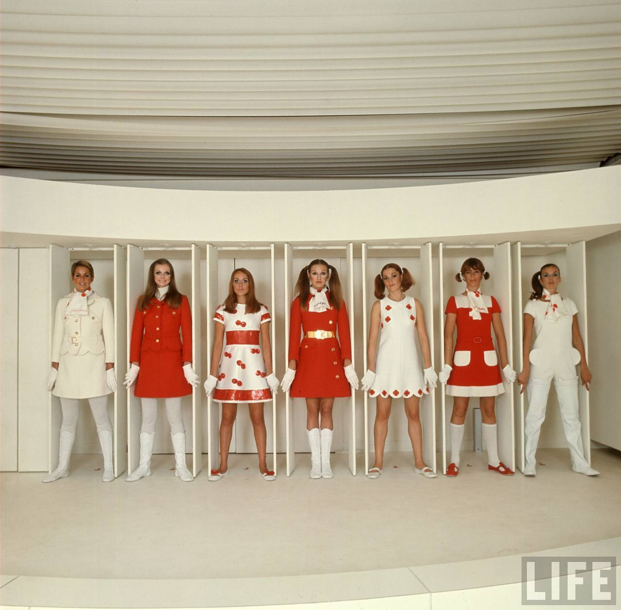 Models wearing red and white ready-to-wear fashions designed by Andre Courreges.