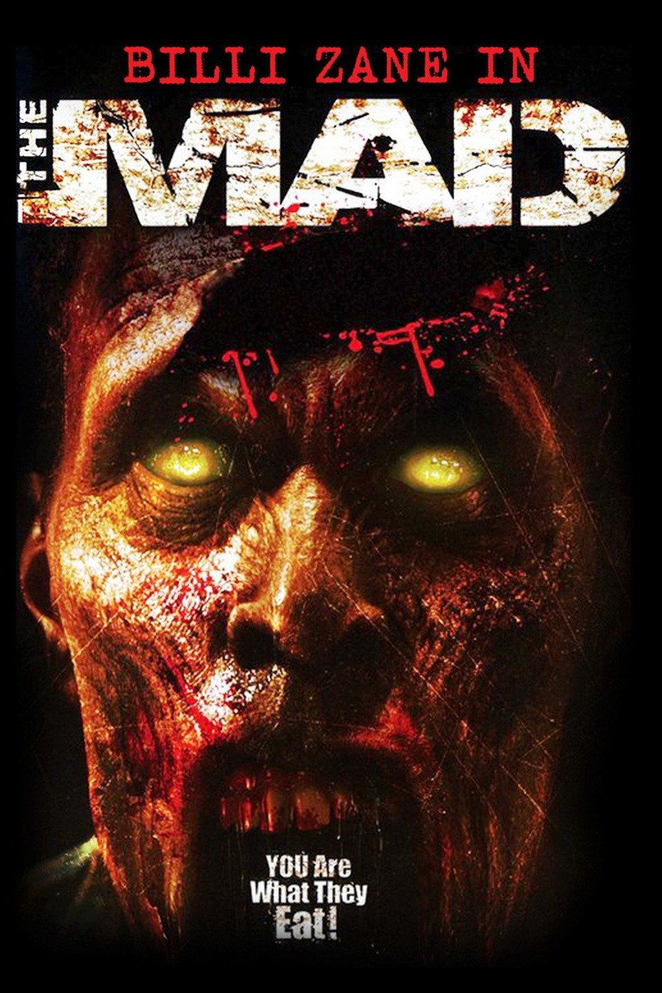 The Mad movie poster with a pupil-less, yellow-eyed zombie covered in blood.