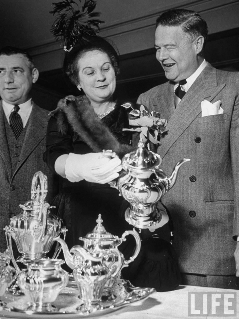 Guest of honor William M. Boyle Jr. (R), looking over a silver service that cost $2,250, given to him at the testimonial dinner by the Democrats.