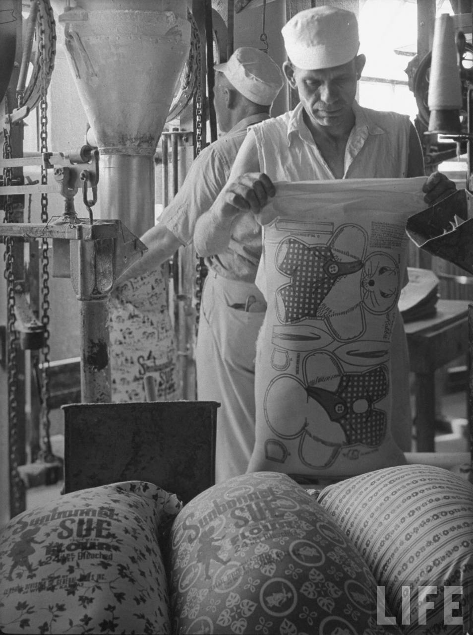 Workers filliing colorfully printed flour sacks which housewives use to make dresses because the labels wash out, at Sunbonnet Sue flour mill.