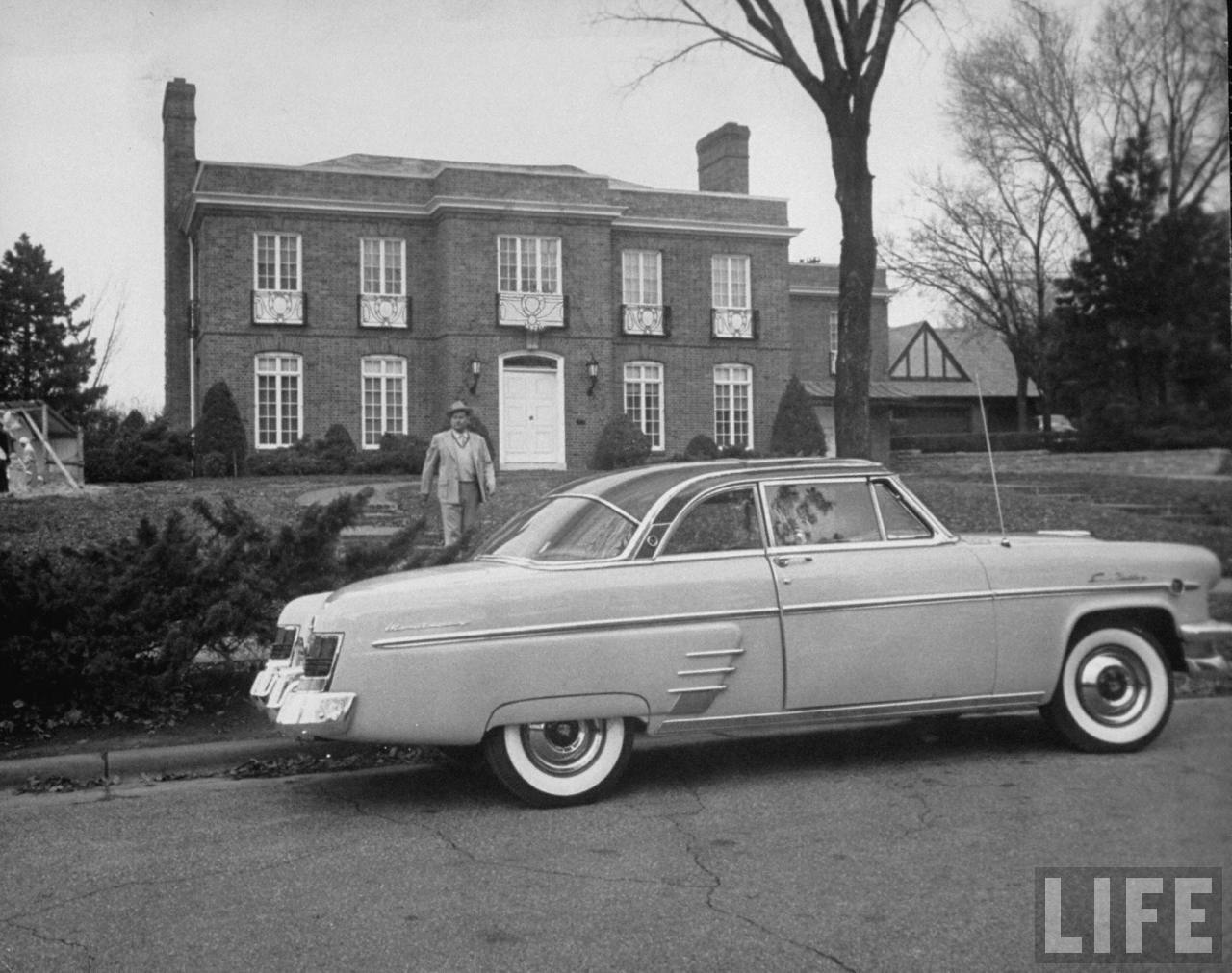 Ford dealer Berl Berry leaving his house.
