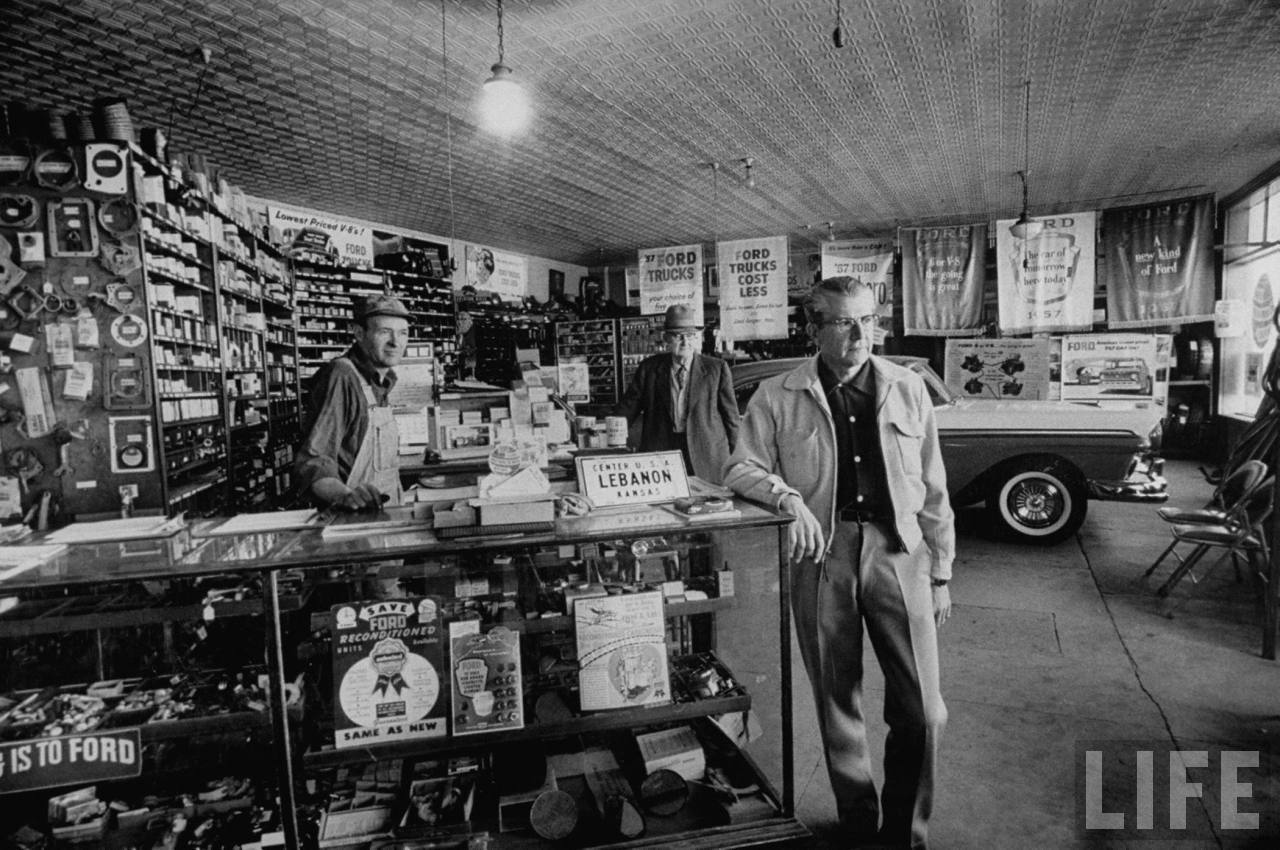 People shopping in an auto parts store in Lebanon, KS.	February 1957