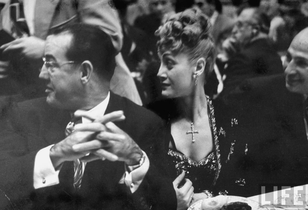 Charles Binaggio sitting with his wife, while attending the William M. Boyle Jr. testimonial dinner.