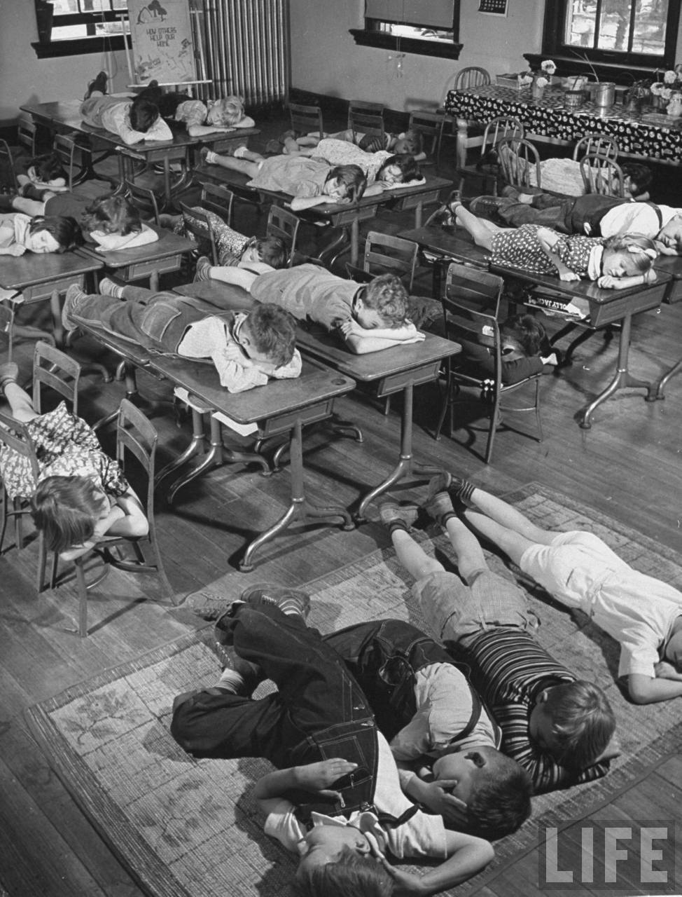 A view of children in school taking a nap in the middle of the day.