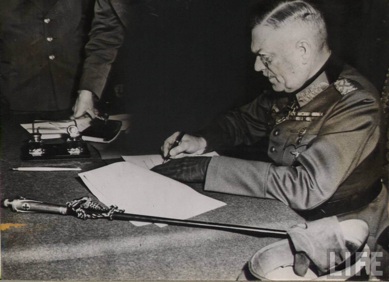 Wilhelm Keitel signs the final German Act of Unconditional Surrender