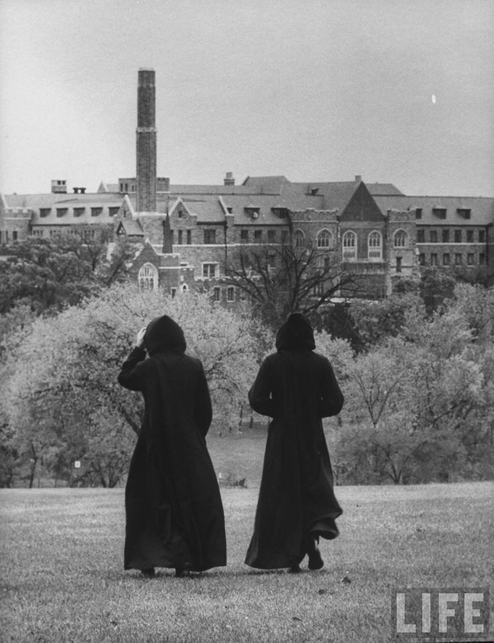 Monks outside monastery, at St. Benedict's Abbey.